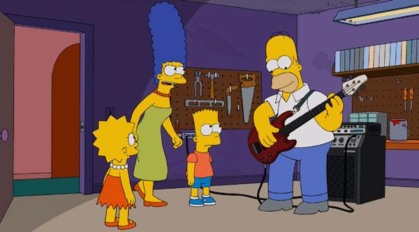 Гомер играет на бас-гитаре