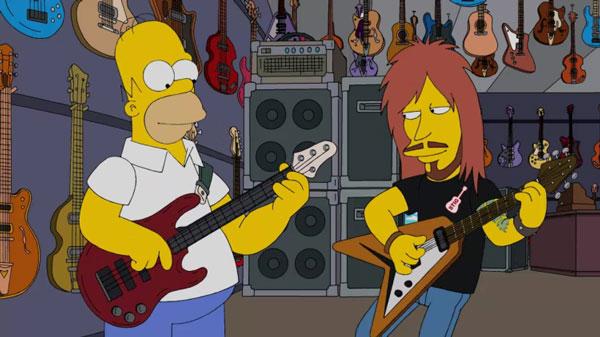 Гомер играет на рок-гитаре