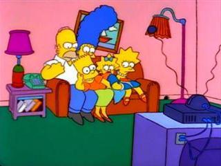 Барт на коленях на диване
